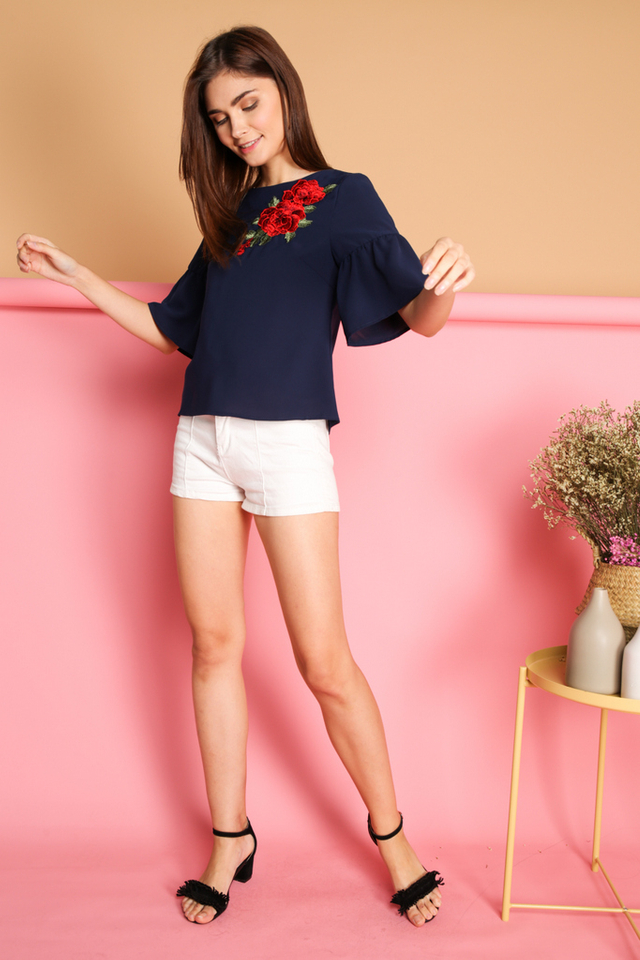 Celia Rose Patch Flounce Sleeve Top in Navy