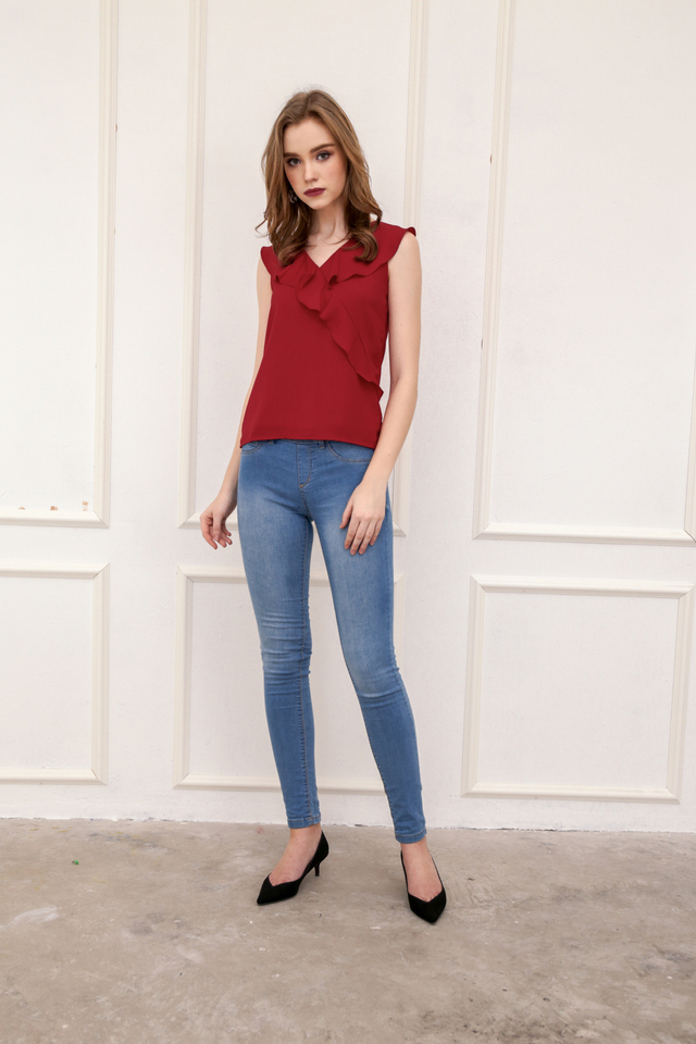 Togi Ruffled Sleeveless Top in Red