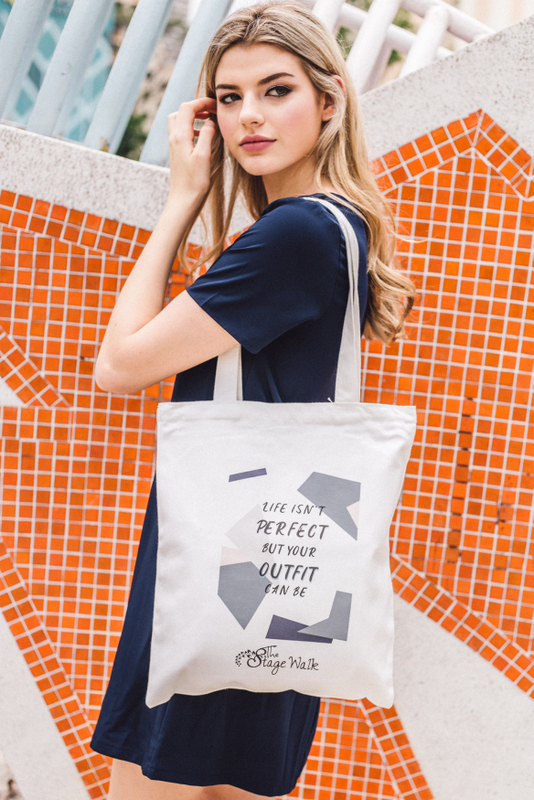 """Life isn't perfect but your outfit can be"" Tote Bag"
