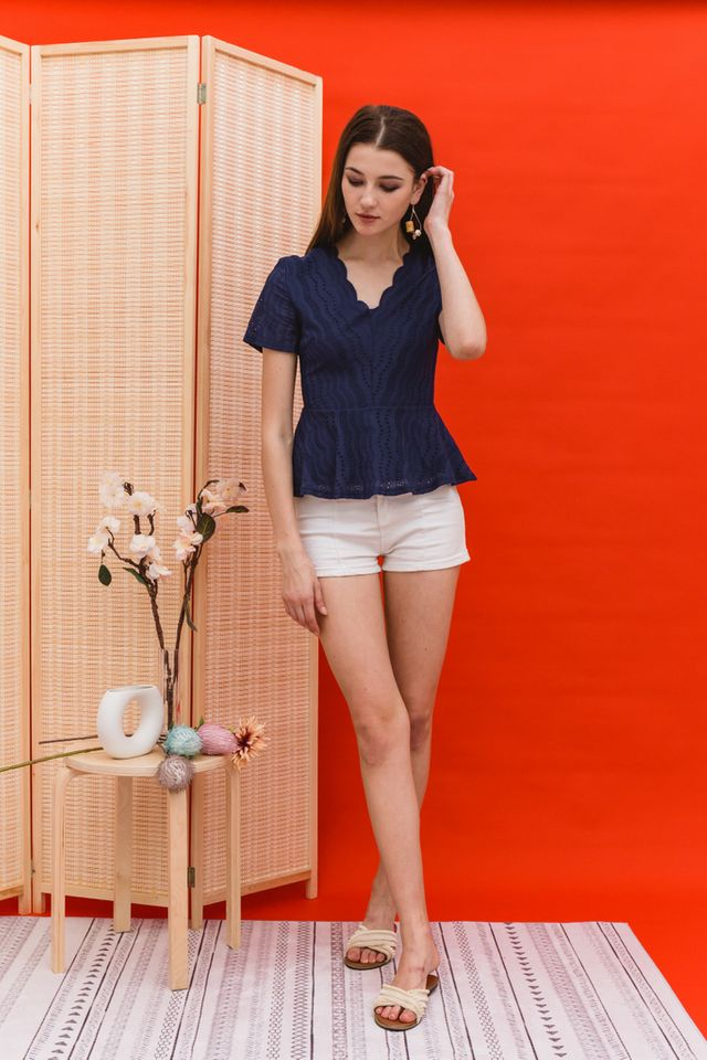 Benecia Eyelet Peplum Top in Navy (XS)