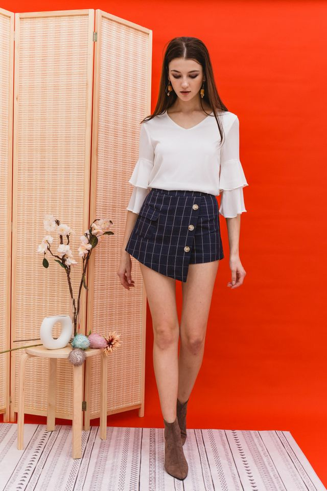 Rilla Plaid Overlay Skorts in Navy