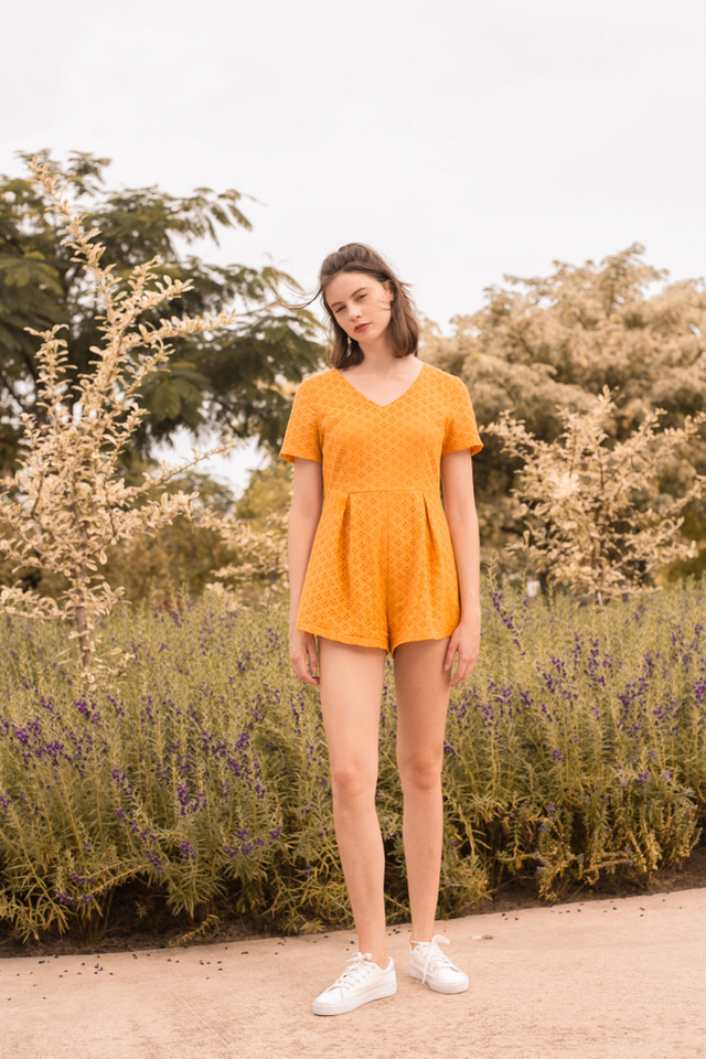 Ariella Eyelet Pleated Romper in Mustard