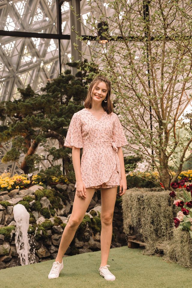 Loraline Floral Faux Wrap Romper in Light Pink
