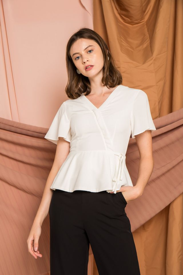 Elaina Faux Wrap Peplum Top in White