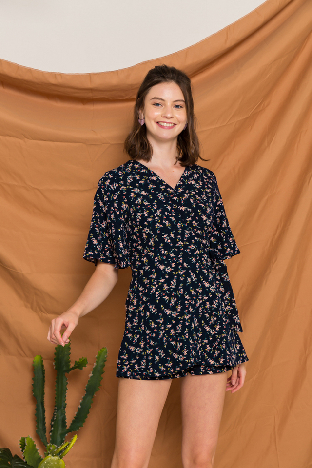 Loraline Floral Faux Wrap Romper in Navy