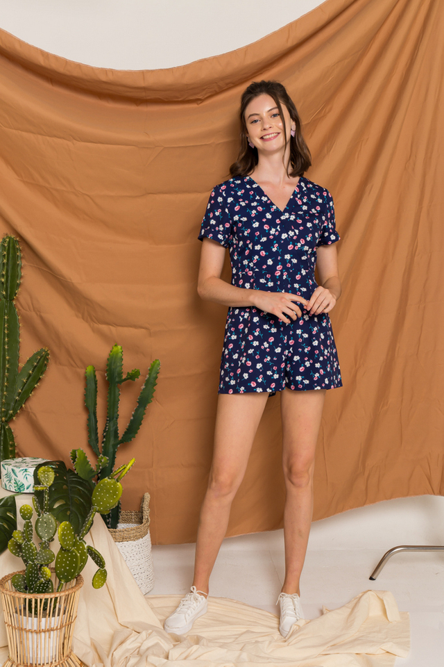 Kori Floral Faux Wrap Romper in Navy