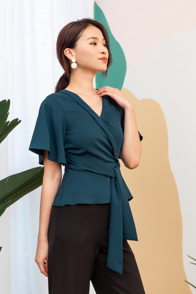 Frieda Faux Wrap Peplum Top in Teal