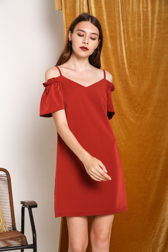 Brielle Elastic Cold Shoulder Dress in Rust