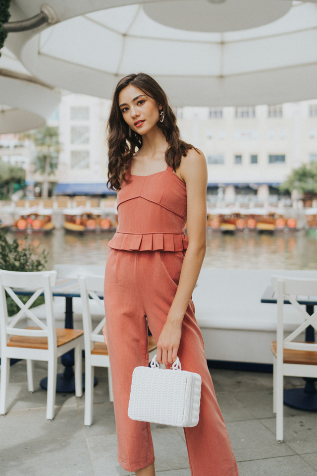Scarlett Peplum Pleated Jumpsuit in terracotta