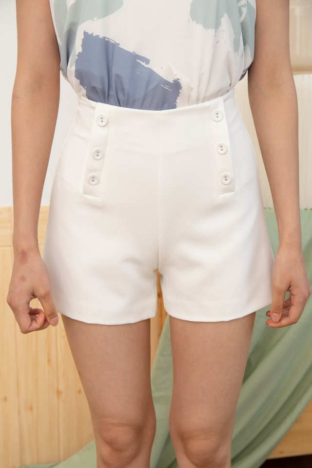Nylah Faux Button Front Shorts in White (XS)