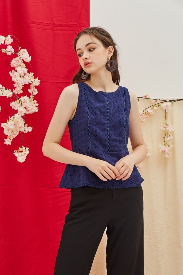 Carlene Eyelet Peplum Top in Navy