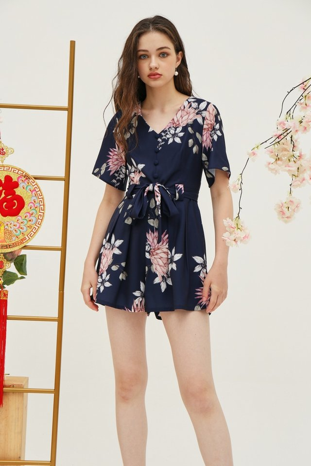 Sammie Floral Pleated Romper in Navy