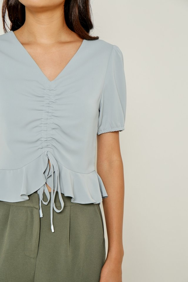 Emilee Ruched Ruffles Hem Top in Blue