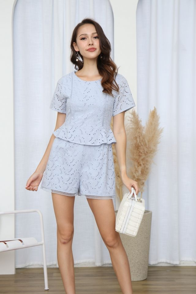 Anwen Peplum Eyelet Romper in Light Blue