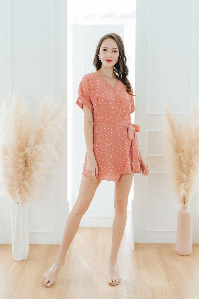 Joana Printed Faux Wrap Romper in Coral Peach
